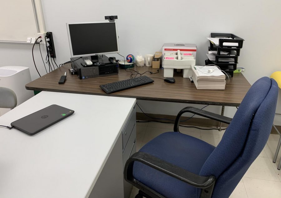 A teacher's desk sits empty as they are forced to quarantine from home for 14 days.